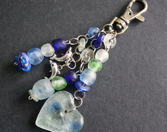 Bag Charm or Key Ring. African, Recycled Glass Beads, with Dolphin And heart Charms. Aqua/Green/Blue/Clear , Beautiful, Great Small Gift