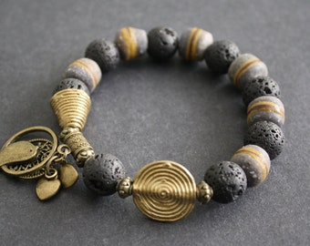 African Jewelry, Beaded Ghana Recycled Glass & Lava Bead Bracelet'Tree of Life, Bird and Heart Charms,  Small Gift for her, Grey/Black/Gold