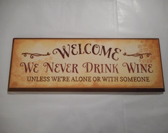 We never drink Wine unless alone or with someone Sign