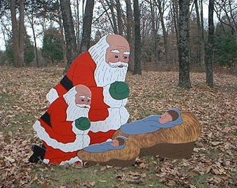 small santa praising kneeling praying before manger crib with baby jesus christ christmas yard art lawn ornament decoration