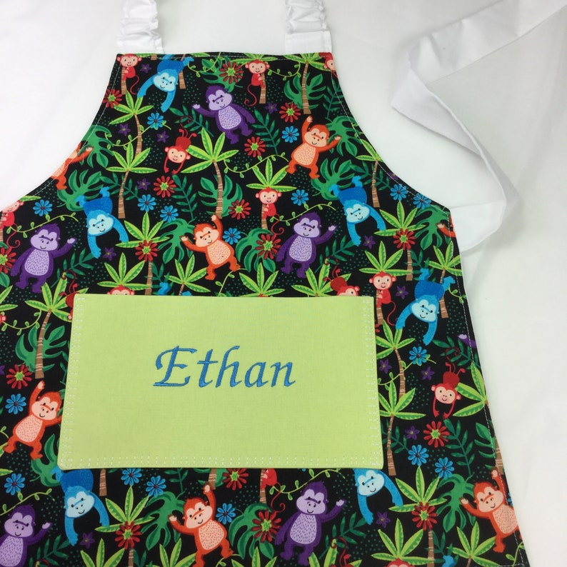 Personalised Kids Monkey Apron: Patterned  With Plain Pocket Monkey All Over