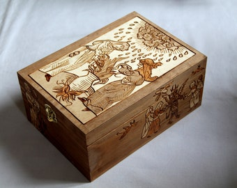 Wooden witches box engraved with medieval patterns depicting devils and witches