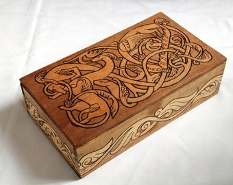 Vintage wooden box carved with viking patterns