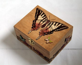 wooden box carved with butterfly with compartment and a mirror