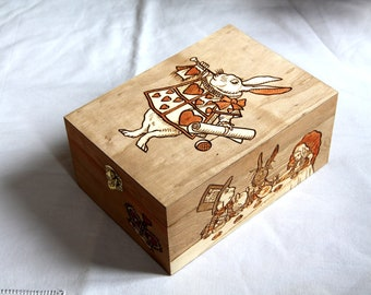 Wooden box carved with Alice in wonderland patterns