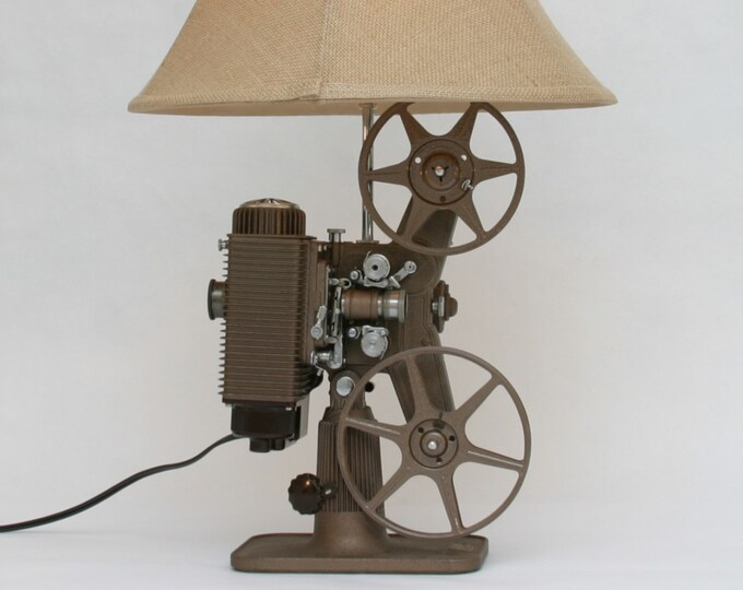 original gift idea.  Vintage movie projector lamp. Revere circa 1940's. (2) Beautiful lighting for any room. Film lovers lamp.