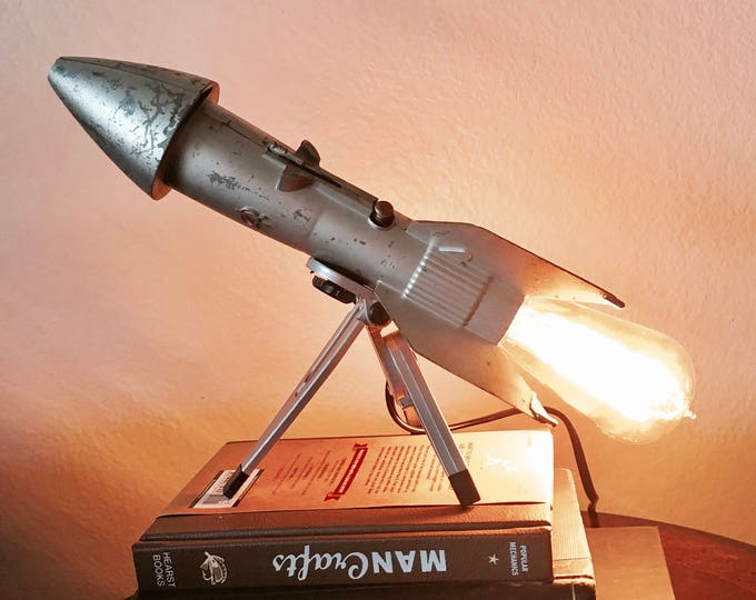 Unique vintage metal rocket lamp.1957 Berzac coin bank  Definitely original gift idea!  perfect desk lamp .