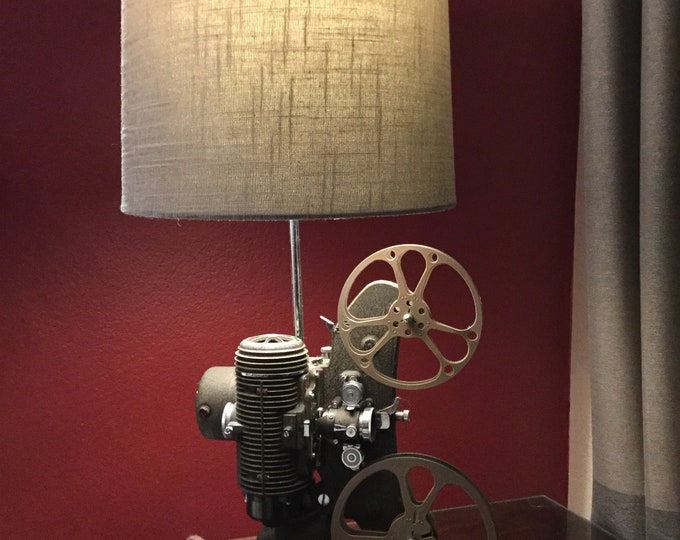Original gift idea.  Vintage movie projector lamp. Revere circa 1940's. Beautiful lighting for any room. Film lovers lamp.