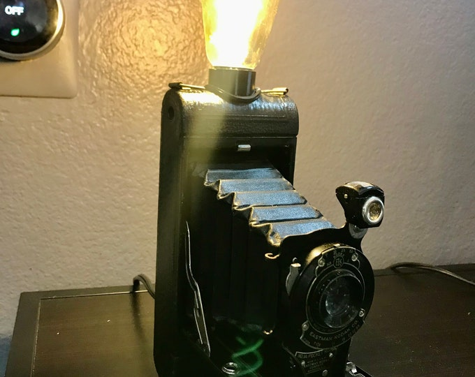 Vintage kodak foldout camera lamp.