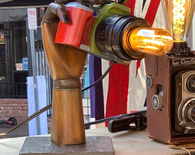 Painted kodak camera with light feature .