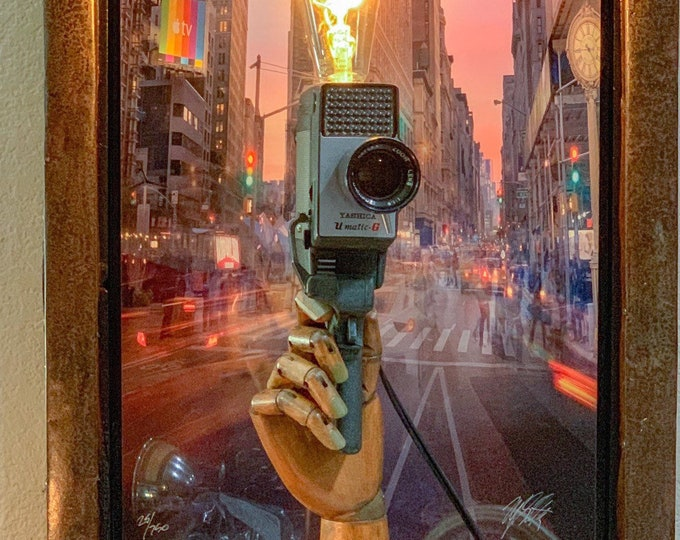 Painted hand with vintage movie camera