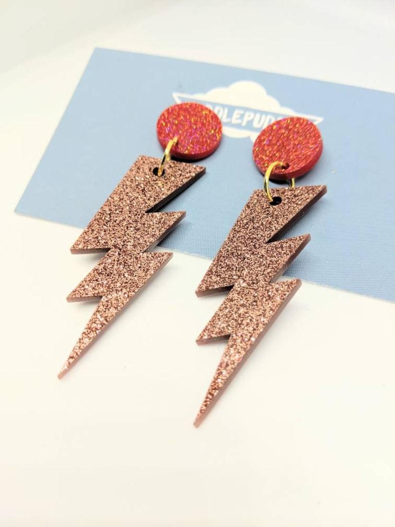 Rose gold lightning bolt dangle earrings image 0