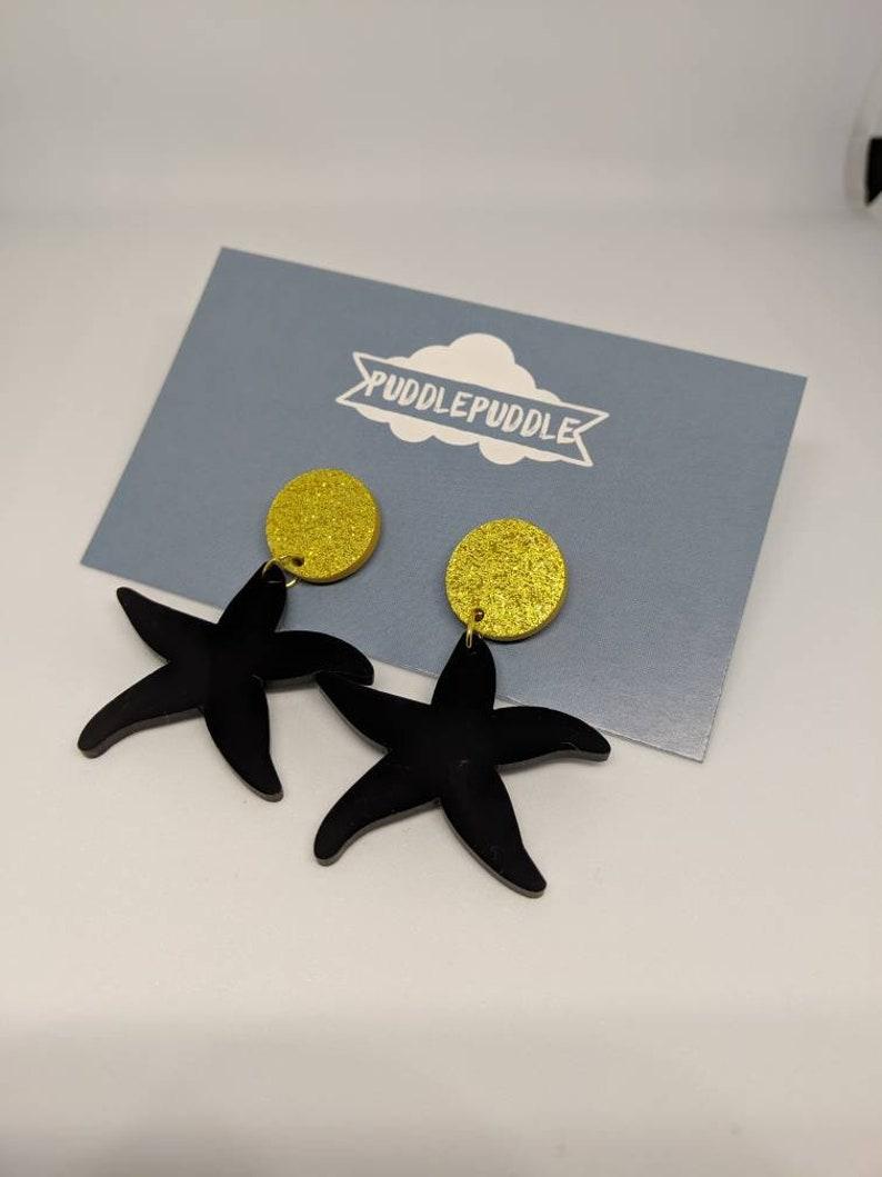 Black acrylic starfish dangle earrings image 0