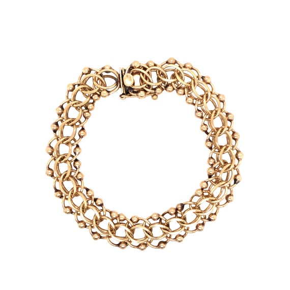14K Yellow Gold Charm Bracelet.
