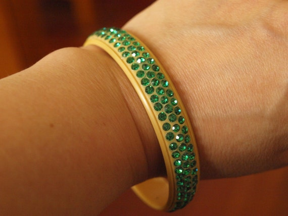 1920's celluloid bangle with green rhinestones