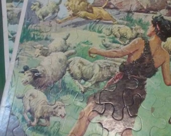 Vintage (2) bible Fram-tray cardboard puzzles depicting scenes from the bible these measure 14 1/2 inches by 11 1/2 inches