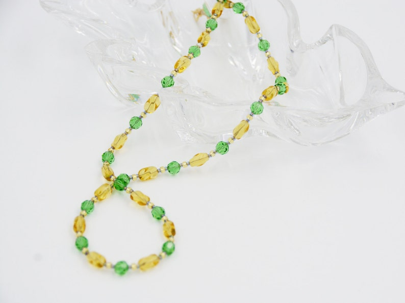 Facetted Czech Peridot Crystals Miyuki Seed Beads and a Gold Plated Toggle Clasp A Necklace of Yellow Twisted Barrel Crystals