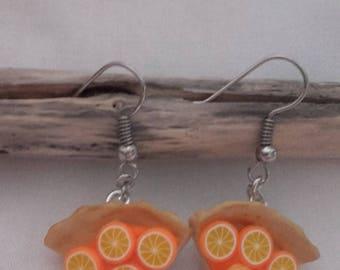 Pie earrings has orange