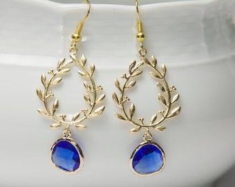 Gold and blue earrings. Blue glass earrings. Gold laurel earrings. Framed Glass earrings. Glass dangle earrings. Cobalt Blue earrings.