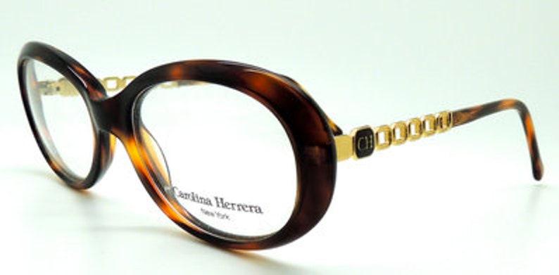 2d734c86cf Womens Carolina Herrera CH 506 Vintage Oval Turtle Acrylic and Gold Metal  Designer Glasses