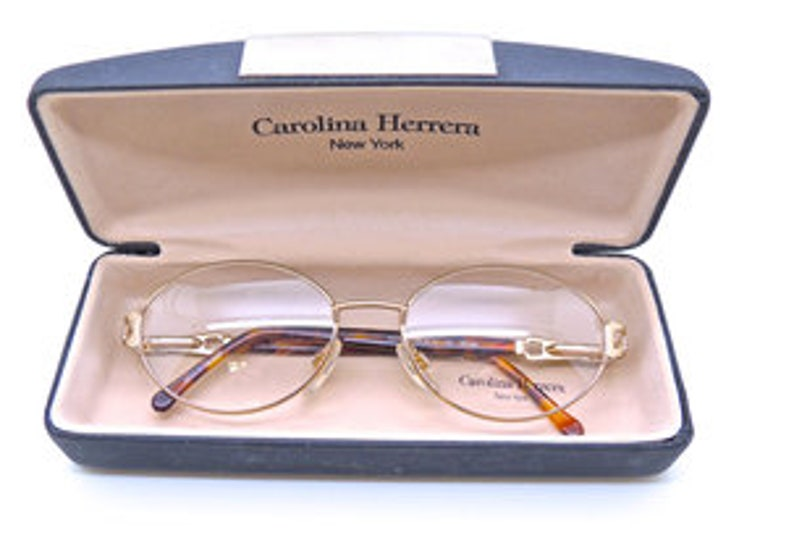 7347db1361 Carolina Herrera 704 Designer Oval Vintage Spectacle Frames In An  Eyecatching Gold And Tortoiseshell Finish