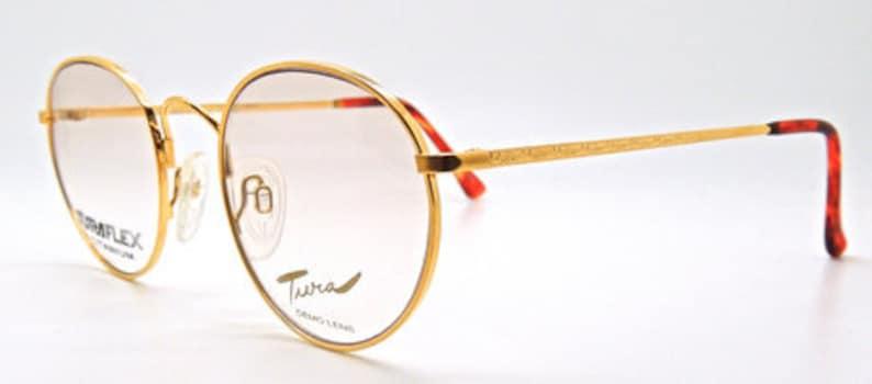520ec4e7a03a0 Superb Tura Flex 878 Titanium Designer Gold Panto Eyewear Frames With  Engraving