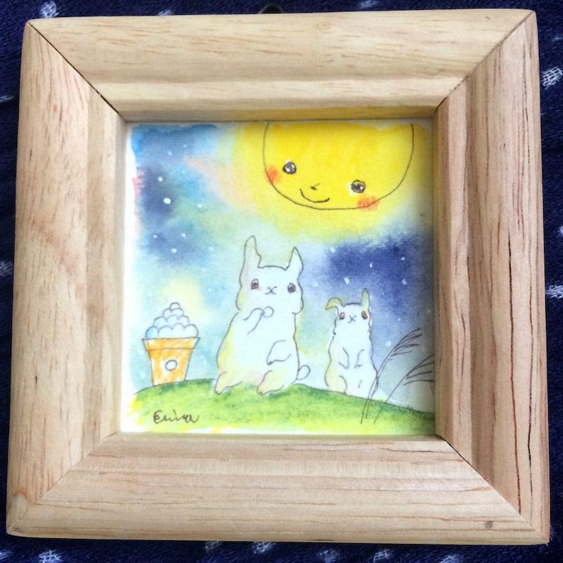 お月見デート  moon viewing date  rabbits eat mochi dango under the image 0