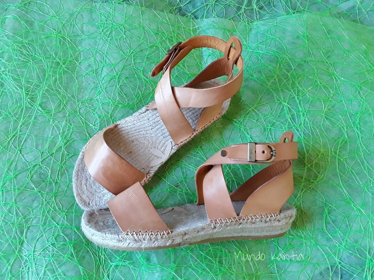 Two strip wide ankle strap espadrilles. Vegetable tannin tanned leather espadrilles. Natural jute sole. Number 35 to 42.