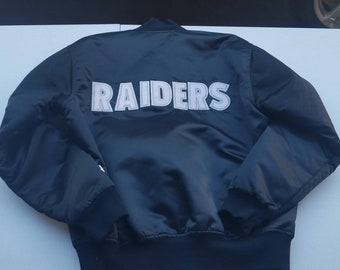 22970cbb313 Large raiders starter jacket