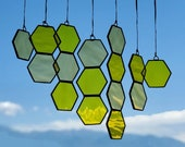 Free-form floating honeycomb suncatcher - two toned yellow glass