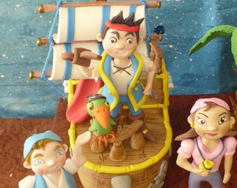 Jake and the Neverland cake toppers, jake, izzy, cubby, skully, the treasure chest centerpiece