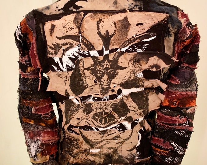 baphomet bleached and dyed denim jacket. With many layers of prints and fabric details on the sleeve. Custom made to suit and fit the buyer