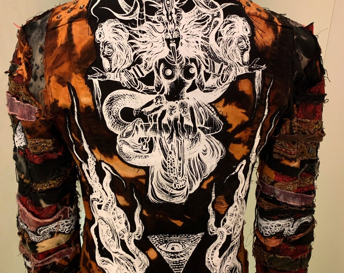 Kali bleached and dyed denim jacket. With many layers of prints and fabric details on the sleeve. Custom made to suit and fit the buyer