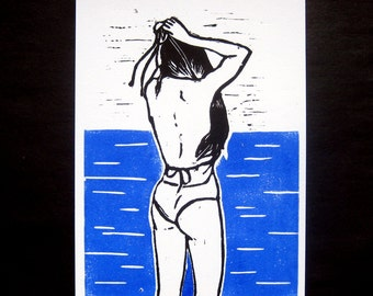 woman bather linocut, black and blue swimsuit, engraving