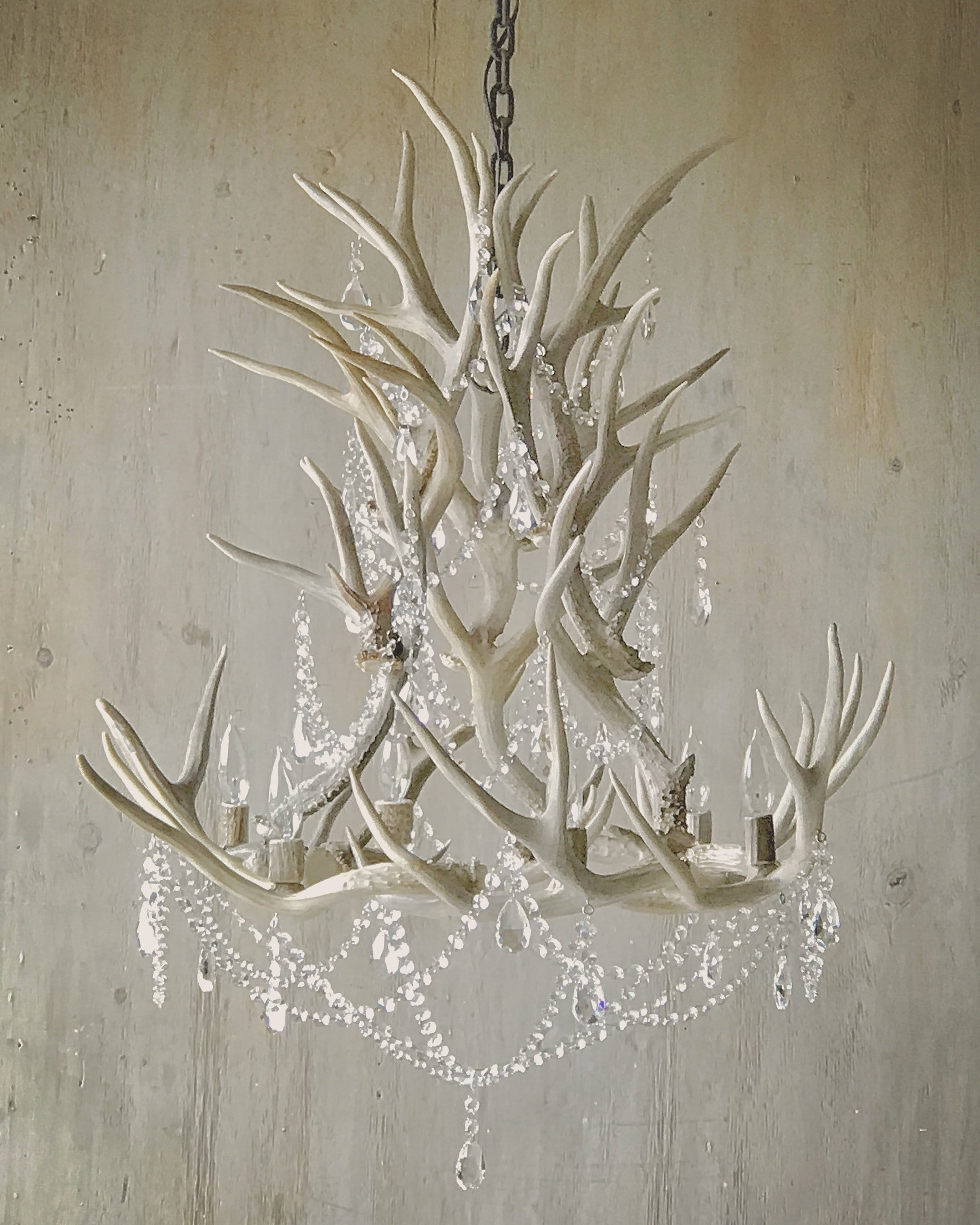 Antler Chandelier, hand crafted from real antlers adorned with authentic leaded crystals.