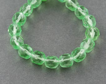2 Strands of Translucent 6 mm Faceted Round Glass Beads - Pale Green (1255)