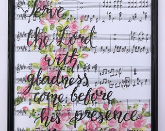 Hand Painted and hand lettered print on a music sheet background.