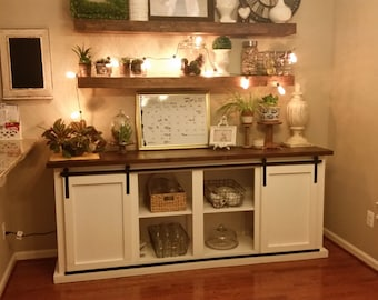Handcrafted buffet table with exposed sliding door hardware.