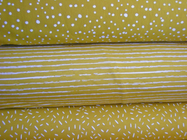 Fabric package jersey mustard yellow with dots stripes and image 0