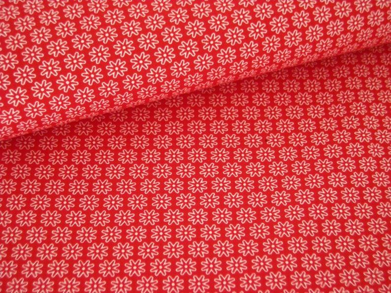 Red cotton fabric with white floral pattern image 0