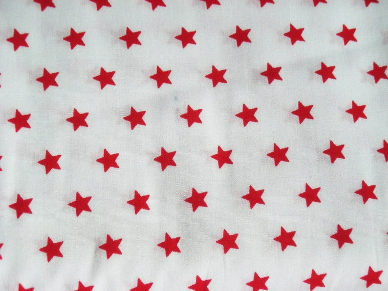 White STENZO fabric with red stars image 0