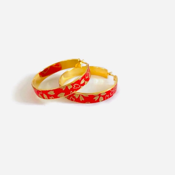 Red bohemian hoop earrings with flower patterns