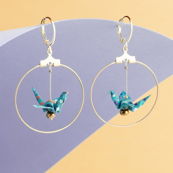 Blue origami cranes earrings in a golden hoop
