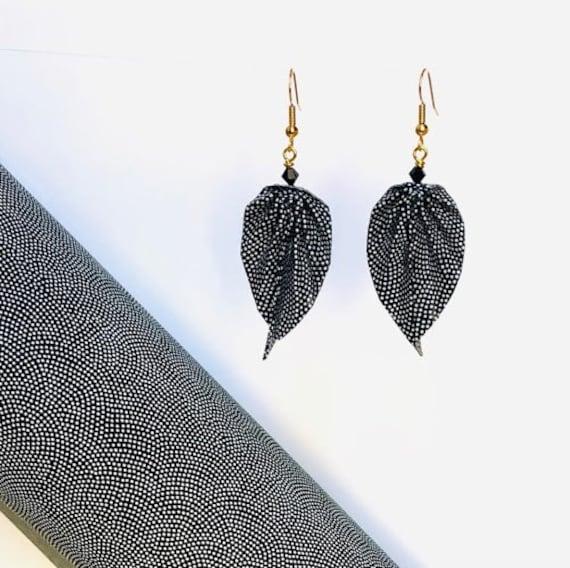 Paper leaves earrings white polka dots pattern on a black base