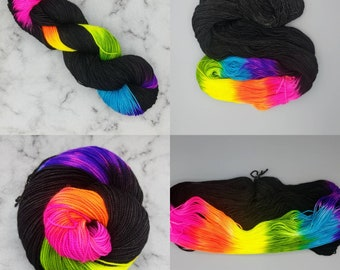 Hand Dyed Yarn - Rainbows after Dark.  Black with a Neon Rainbow repeat. Preorder - Sock, fingering, DK, worsted, Aran, bulky, Chunky.