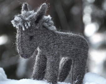 The donkey gray knitted toy