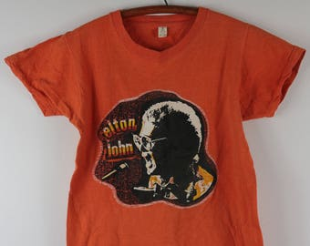 5ded0ecb 1970s Elton John Parking Lot Concert Tour Heat Press Tee Orange T Shirt -  Small