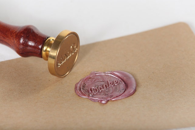 Sealing stamp round with lettering thank you brass and wood