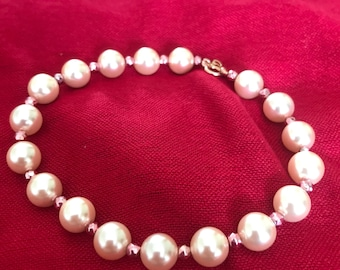 Pink shell pearl braclet with pink pyrite faceted rounds