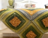 Dandelion Dance Afghan hand knitted from Drops Nepal wool and alpaca yarn mix.